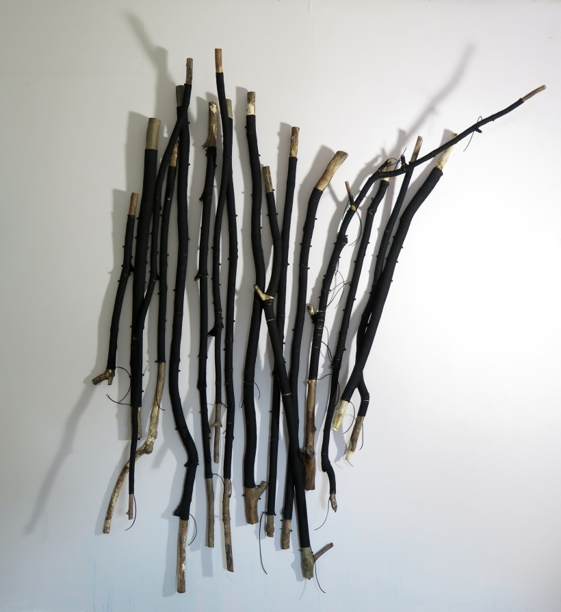 Lyn Horton, First Trees Installation, 2018, 79.5 in h x 66 in w x 12 in d, wood saplings and branches wrapped in velvet flocking mounted to the wall with screws