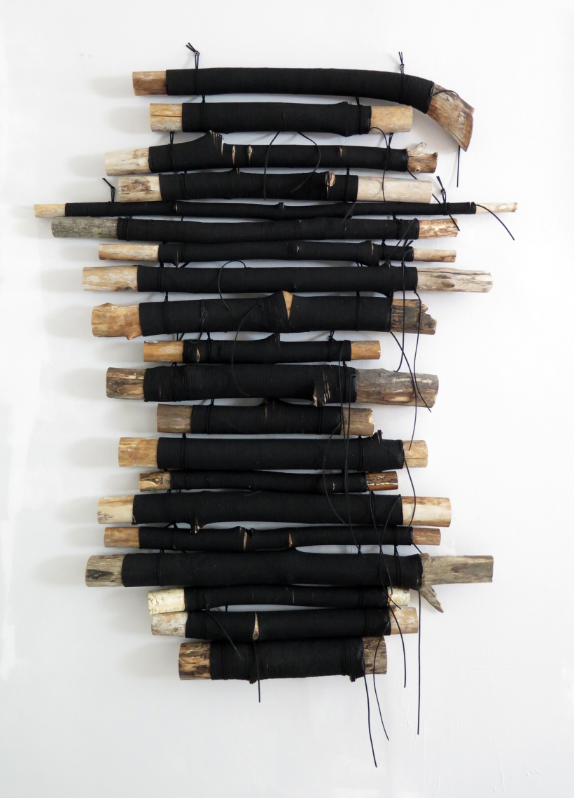 Lyn Horton, Stack of Wood, 2018, 55.25 in h x 37. 75 in w x 4 in d wood and velvet installation mounted with black screws