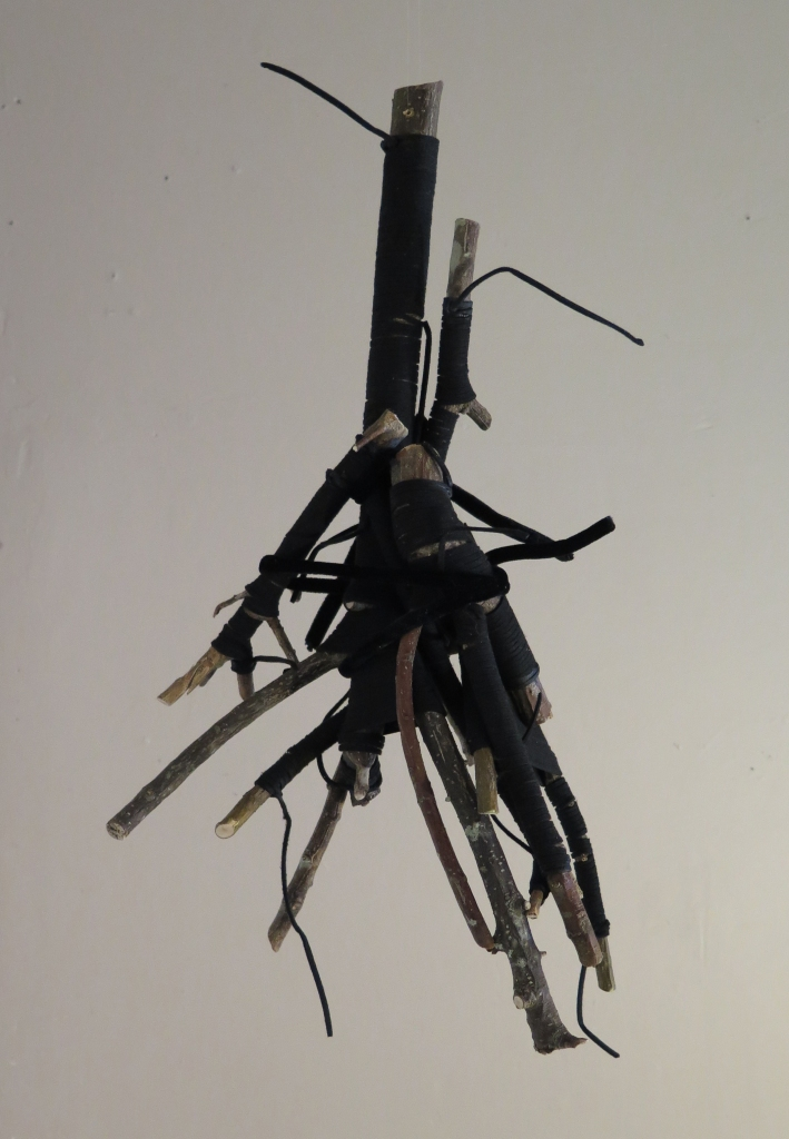 Lyn Horton, All Tied Up #1, 2020, branches wrapped in faux leather and velvet tubing, 17.75 in h x 9.25 in w x 6.25 in d