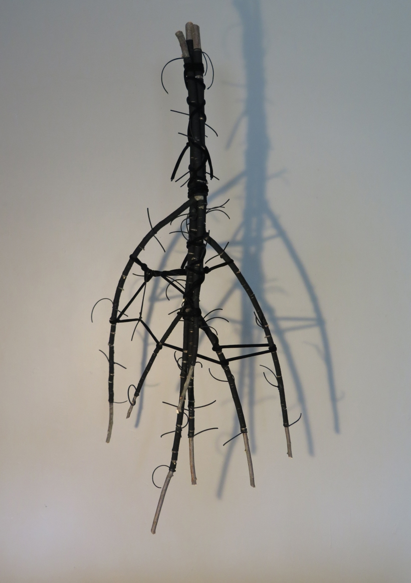 Lyn Horton, All Tied Up #7, 2020, branches wrapped in faux leather and velvet tubing, 48.25 in h x 18 in w x 14.75 in d